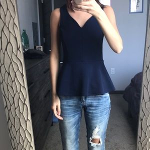 Blue sleeveless peplum top